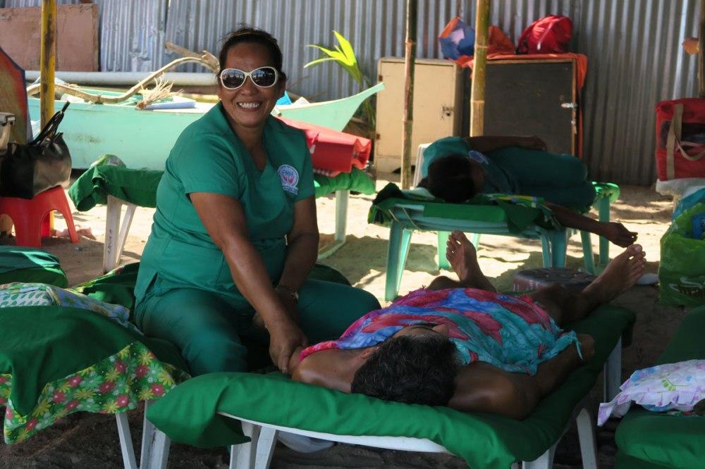 Smiling masseuse begins her work